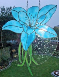 Blue lily - interesting use of clear glass to sturdy-up the piece