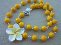 Sunshine Frangipani Necklace by EyeKandyJewellery on Etsy, $30.00