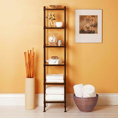 Assemble a wood etagere in your bathroom to store items on display and close at hand. Dress it up with mirrored shelves and accents, such as glass vases, basins, and tins. Keep towels handy toward the bottom and use a basket to store extras if needed.