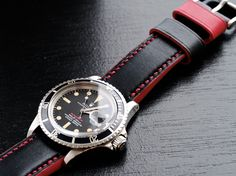 Vintage Rolex Red Submariner spotted with Black/Red watch strap by eatsleeplay.