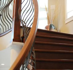 These curving iron slats look great on a curving staircase, but how would they look on a straight staircase?