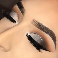 The silver sparkly streak at the top of the eyelid is soo cute! This is the perfect look for a formal event!