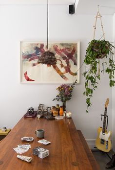 Eclectic decor, indoor hanging basket plant and wall art.