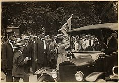 """""""Suffragists arrested for picketing the White House. Photo shows suffragist arrested in front of the White House, Washington, District of Columbia, being escorted into an auto which took her to the station house."""" 07/14/1917 (NAtional Archives, Record Group 165, ARC 533776)"""