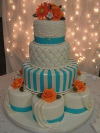 Turquoise and orange  I love the smaller cakes for the bottom tier