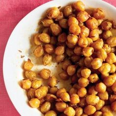 Spicy Roasted Chickpeas A spiced nut alternative. Simple ingredients and quick bake time. *Yuck! The major problem with this recipe is that the seasoning didn't stick to the chick peas since they weren't moist. It all fell to the bottom of the bowl so it tasted bland and very dry. Completely pointless food. Don't waste your time!
