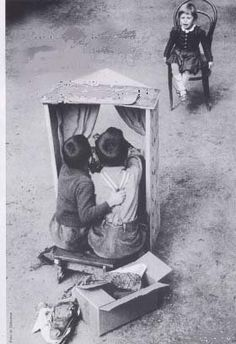 One audience puppet show - Who had more fun? The little girl watching or the two children performing? Wonderful vintage photo!