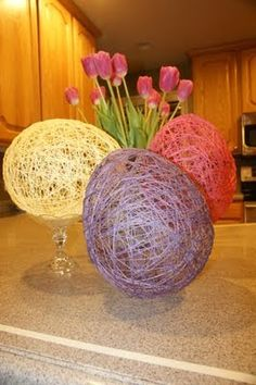 Easter eggs made with string dipped in glue and then wrapped around a balloon. Hang to dry overnight, then pop! Neat!