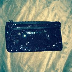 Victoria's Secret clutch Black sequin Victoria's Secret clutch. Two departments with zipper closure. No issues and perfectly clean. Measures five by nine inches. Victoria's Secret Bags Clutches & Wristlets