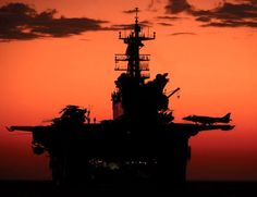 COOL NAVY PICTURES - SILHOUETTE OF AIRCRAFT CARRIER IN SETTING SUN!  JETS ON DECK!