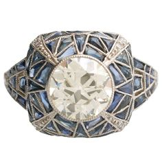 Super awesome ring ~ diamond set against geometric and multi-cut blue sapphires