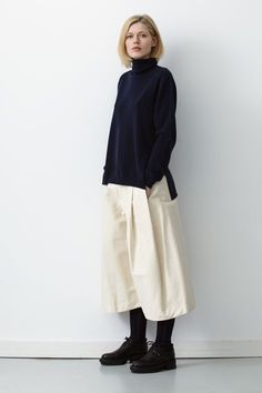 Polo neck jumper, and white culottes