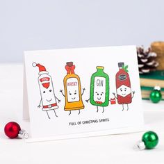 This funny alcohol inspired Christmas card features hand drawn illustrations of cheeky looking spirit bottles including gin, vodka, whisky and rum in a playful nod to the phrase Christmas Spirits. This Christmas card is sure to raise a smile and be appr Christmas Puns, Cute Christmas Cards, Funny Holiday Cards, Christmas Card Packs, Homemade Christmas Cards, Noel Christmas, Handmade Christmas, Christmas Crafts, Christmas Ecards
