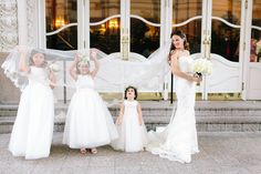 Stephanie in her gown from Yvonne LaFleur, accompanied by some lovely little ladies in white