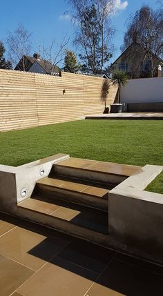 Our contemporary slatted fence panels can introduce a modern clean style to screen or fence your garden in St Albans, Hatfield Hertford and Welwyn Hertfordshire Sloped Backyard Landscaping, Landscaping Retaining Walls, Sloped Garden, Backyard Patio Designs, Garden Design London, Back Garden Design, Modern Garden Design, Back Gardens, Outdoor Gardens