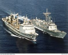 GULF OF OMAN? C.1990-10. HMAS DARWIN (04) DURING REPLENISHMENT AT SEA FROM HMAS SUCCESS (304). NOTE THE AUSTRALIAN FLAG PAINTED ON THE MID SHIP SUPERSTRUCTURE OF HMAS SUCCESS. (DONOR R. SHALDERS)