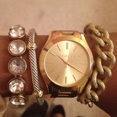 Michael Kors watch and bracelets.