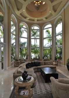 Arched windows in a round sunroom with palm trees. I think I lived here in my previous life.