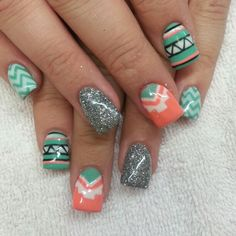 Acrylic nails. Coral and turquoise shellac. Aztec,  Chevron,  and silver glitter.  Instagram: @boop7111