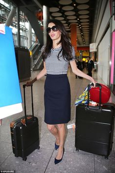 Dressed in an elegant black and white two-piece ensemble from Oscar de la Renta and black court shoes, Amal Alamuddin Clooney cut a sharp figure at London's Heathrow airport http://dailym.ai/1nzvdZM