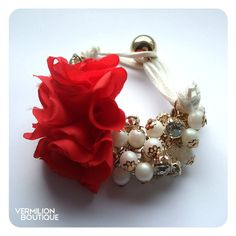 Red corsage flower bracelet with diamantés and cream pearl beads.