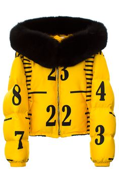 MOSCHINO YELLOW CROPPED RULER PUFFER Yellow cropped puffer jacket featuring black ruler print, fur hood and two pockets. Zip-up closure with snap buttons and bungee cords at neck. Made in Italy. SIZE & FIT Women's sizing. Fits true to size. MOSCHINO Founded in 1983 by Franco Moschino, Moschino is an Italian luxury fashion house with a legacy of iconoclastic, witty, extravagant designs that satirize the fashion industry. Jeremy Scott is the current creative director.