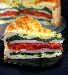 lTourte Milanese: Layers of herbed scrambled eggs, ham or turkey, garlic spinach, swiss cheese and roasted red peppers encased in puff pastry. A great brunch stunner plus it is easy!