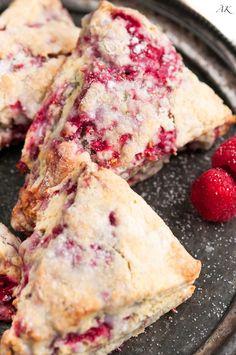 Lemon Raspberry Scones Recipe - Easy homemade scones made with fresh raspberries tempered by tart lemons, and topped with a sweet lemon glaze. Lemon Scones, Rasberry Cookies, Just Desserts, Dessert Recipes, Cookie Desserts, Raspberry Recipes, Raspberry Bread, Raspberry Muffins, Tea Time