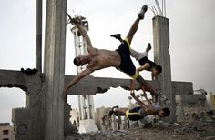 Photographer of the year – 2015 shortlist: atrocities in Paris and Syria, bodybuilders in Palestine | Art and design | The Guardian
