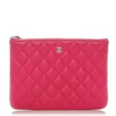This is an authentic CHANEL Lambskin Quilted Medium Cosmetic Case in Dark Pink.  This stylish case is crafted of luxurious lambskin diamond quilted leather in pink.  The bag features a top zipper pocket that opens to a protective quilted nylon interior.  This pochette is practical with the timeless style only from Chanel!