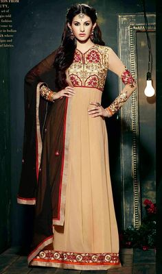 Bewitch onlookers with this beige embroidered chiffon georgette floor length Anarkali dress. It is uniquely crafted with lace and resham work. #MagnificentBeigeEmbroideredFloorLengthAnarkaliSuit