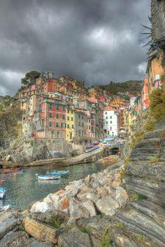 """Riomaggiore Cinque Terre Italy - The Cinque Terre, are five small villages on the """"Costa Ligure of Levante"""". The villages from north to south are: Monterosso al Mare, Vernazza, Corniglia, Manarola, and Riomaggiore. Since 1926, the Cinque Terre towns have been part of the province of La Spezia."""