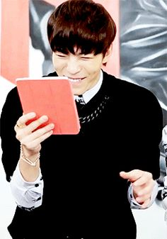 Hongbin's smile causes others to smile. Because it is smiling perfection. The boy should wear a warning sign, or I'll go blind. - VIXX