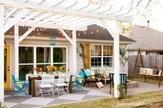 wood table, metal chairs,check. conversation area, check. porch swing, check. some say my patio will resemble this! House of Turquoise: The Handmade Home Tour