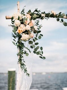 Rose and eucalyptus wedding arch: http://www.stylemepretty.com/little-black-book-blog/2017/01/09/al-fresco-seaside-summer-wedding/ Photography: Michael and Carina - http://www.michaelandcarina.com/