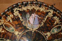 Early 19th century tortoise-shell Brise hand fan - hand-painted and pierced.