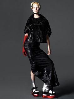 East of Eden - TRick Owens python jacket and silk blend skirt. We Love Colors fishnet knee-high (worn as headpiece)