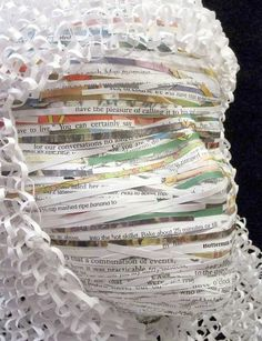 "Artist Susan Brandt's ""Self-Portrait"" attach word strips over the plaster mask forms and add curled paper for hair-good mixed media ideas"