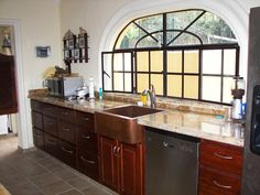 copper kitchen sink with granite countertop and glass windows are also some other furniture