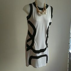 White/Black dress 35% cotton/65% polyester. Great fit. NWOT Dresses Mini