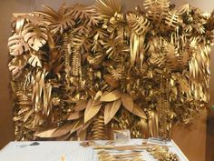 Gold Foliage-this feels a bit too tropical but I think there is something here for maybe repeating the gold pendants as a wall display somehow..