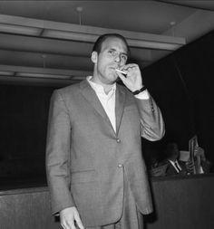 Crazy Joe Gallo smoking a cigarette