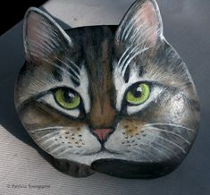 This painted rock was made by an artist and is one of many available via Gifts by Helen. For details you may email her @ mailto:hvendorhou... but please indicate you saw it here on Pinterest in the subject line. TLLG's blog posts about painted cat rocks are @ http://www.thelastleafgardener.com/search/label/Painted%20Rocks