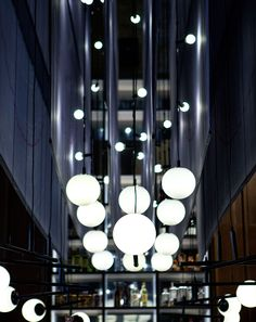 The Carbon Bar, Toronto, Canada - VISO Rhea led & custom fixtures: Pentograph lights, custom fabric chandelier and other designs around the restaurant. Restaurant Designer: Giannone Petricone with Lightbrigade Photographer: Paula Wilson