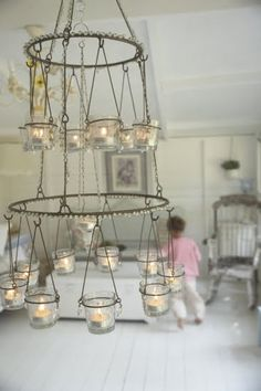 Pretty Candle Chandelier made from what looks like a spice drying rack.