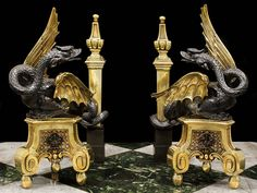Antique bronze dragon chenets with brass wings and pedimented supports