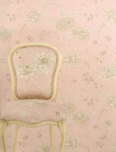 Pale pink and gold chair blends into wallpaper made with the same pattern!