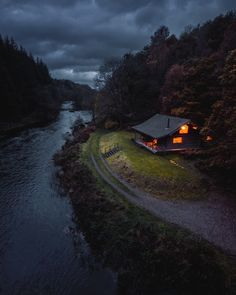 A riverside cabin in The Lake District in northwest England. Photo by Cabin In The Woods, Into The Woods, Cabin On The Lake, House Near Lake, Forest House, Forest Cabin, Lake Forest, Cabins And Cottages, Lake Cabins