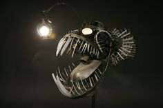 amazing Deep Sea Angler Fish lamp is made with recycled objects and energy efficient lighting