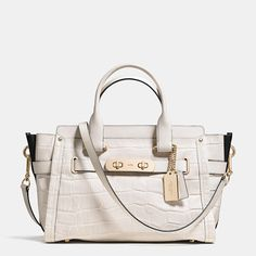 """The most iconic piece of Coach hardware has been reimagined as an elongated, double-turnlock statement piece, updating one of our most popular designs with a little bit of """"swagger."""" Named for a bold, brass-trimmed Bonnie Cashin design from 1967, this spacious, modern carryall is finished by hand in tactile croc-embossed leather with a detachable strap for shoulder or crossbody wear."""